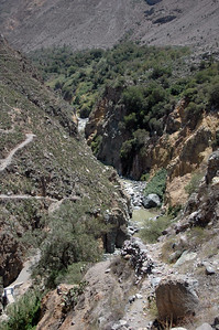 COLCA CANYON, PERU: Looking up river from above the Oasis. Note the river bridge in the lower left corner.