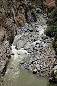 COLCA CANYON, PERU: A green raging Rio Colca (Colca River).