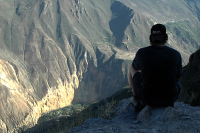 COLCA CANYON, PERU: Forrest initiates a much appriciated rest on the climb out of the canyon. He picks a spot with a good view! We're nearly out.