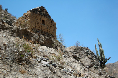 COLCA CANYON, PERU: Remains of a house perched up over the river near the base of the canyon.