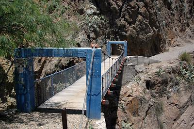 COLCA CANYON, PERU: Bridge over Rio Colca at the base of the canyon.