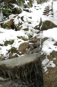 Ice covering the rocks on Spur Trail and the snow covered log ladder up trail.