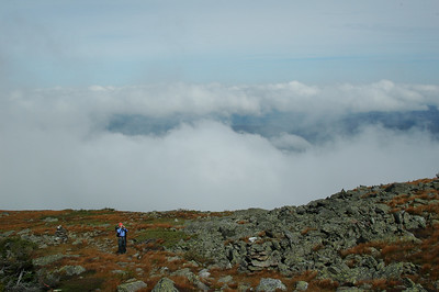 Meggen stops to take a photo on our way up to Mt. Adams (5,799') above the clouds to take a photo.