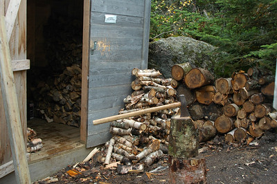 As the temperature starts to drop, I head out around back of Gray Knob Cabin to the wood shed to start splitting wood to stay warm. I won't use any of this fire wood... it's being stacked inside to cure for a year. The fire wood that will be used by this winter's caretaker is in the door to the left and was split by last year's Fall Caretaker.