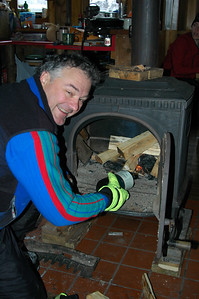 But, the fire has a little trouble getting going, so Mike hits it with the blowtorch.