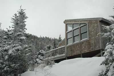 A touch more snow and gray weather at Crag Camp.