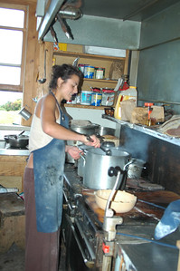 Gina is the Naturalist over at Madison Hut, my closest neighbor. They have a staff of five and each take turns as cook for the day. At Madison, they give you a bunk, a mattress, a blanket, 3 meals and an evening program all for the bargain price of $80/night! Or come take care of yourself at Gray Knob with me for $12.