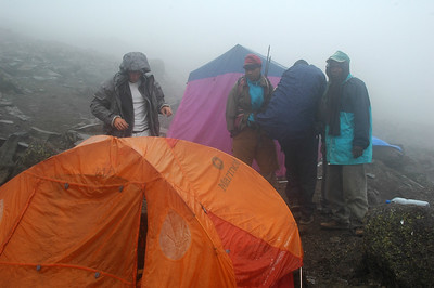 KILIMANJARO: We get back down from the summit around 10am.  A warm lunch was enjoyed while a light rain turns to snow (gropple). A nap until 1pm when we are forced from our cozy tents to continue down the mountain to our last camp, Mweka Camp for dinner.