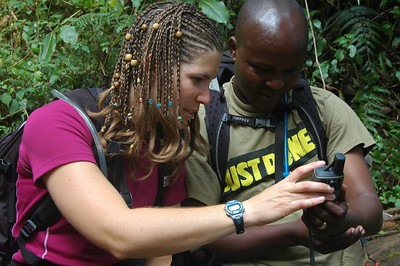 KILIMANJARO: Amy, our trip organizer, shows Nelson, our chief guide, the tracking route on her GPS.