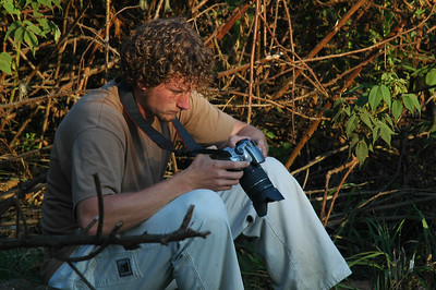 KILIMANJARO: Eric takes a moment to play with his camera before the golden hour of good light begins for photography.