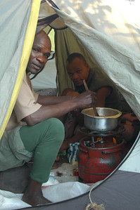 KILIMANJARO: Dinner is on. Our cook works in his tent to make us soup, pasta, rice, chicken and so much more, including packing us a lunch box each day to enjoy on the trail.  Check out that stove. One of the boys had to carry that up. And it came all the way up to our highest camp at 4,600m.