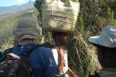 KILIMANJARO: We saw this so often one might think we would get used to seeing the porters carrying loads balanced on their heads like this, but it never ceased to amaze us.