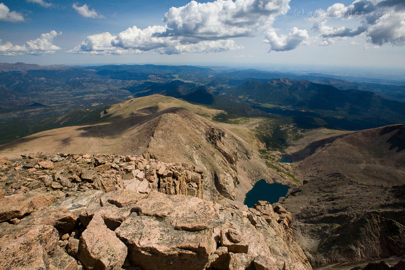 LONGS PEAK, CO - Looking east down from the summit onto Chasm Lake and beyond the front range.