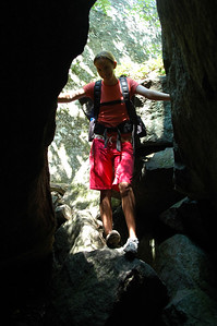 McKenzie looks down through one of the larger gaps between the rocks as we start our transect through Mahoosuc Notch.