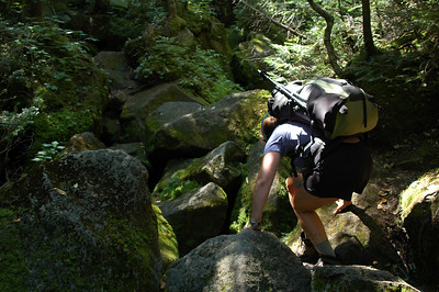 Dawn steadies herself as she works her way across and over the slippery moss covered rocks in the notch.