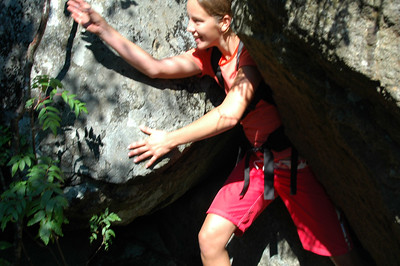 McKenzie reaches for a tree to help pull herself through this tight squeeze.