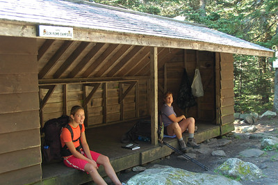 Our first major stop before lunch: Speck Pond Shelter. The girls look like they're happy to sit.