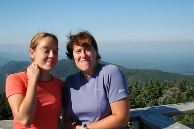 The girls atop the fire tower on Old Speck Mountain. They look like they're trying to keep from laughing while holding a mouthful of water, but really they're just clinching at the cool wind whipping by.