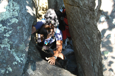 Dawn tries to figure where to place her hands to work her way up this narrow chimney.