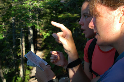 Part way up the Eyebrow on the trail up to Old Speck Mountain, Dawn and McKenzie practice their map reading and route finding skills.