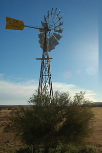 This windmill is set up over a water well and slowly pumps water up to the surface and into a holding tank. But only when the wind blows.