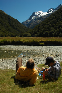 Cameron and Derek taking lunch at the Routeburn Flat with a view of Mt. Somnus (2293m)