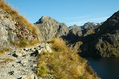 The trail passes high above Lake Harris which is so clean and pure, it beckons us jump down for a swim.