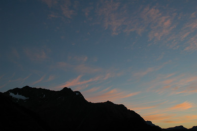 The first light on the clouds the next morning as we're hiking away from the Routeburn Falls Hut.