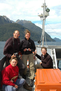 There we all are on the boat back to Manapouri: Tom (red), Michiel, Annemiek and Derek