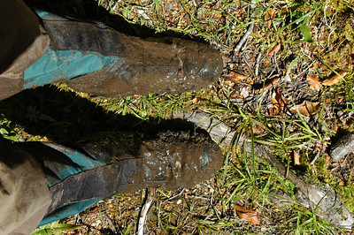 Boot check. Whew, my boots are still there, but we have to look past the thick layer of mud to realize that.