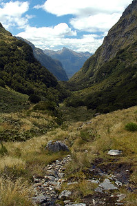 Back on the main trail, heading down into the valley from the pass, a new river starting to form under my feet.