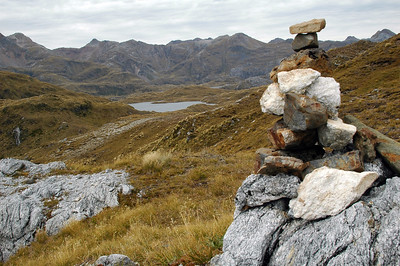 A sole cairn, a small peak in a scene among many peaks.
