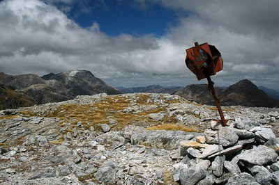The summit of Mt. Memphis with a shoddy old radar beacon supported by slack wires and a pile of rocks.