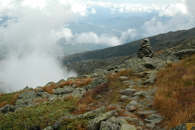 Along the Appalachian Trail, a carin marks the way and a whisp of cloud pokes up from King Ravine on the left.