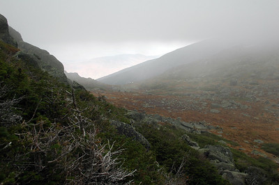 Descending back down to Edmond's Col and dropping back out of the overcast sky.