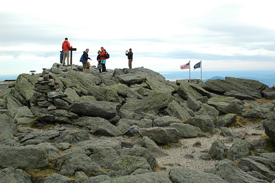 The folks gathering at the sumit of Mt. Washington for their hero shot.
