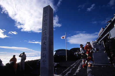 After viewing the sunrise, visitors go about their visit at the summit of Mt. Fuji.