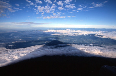 MT FUJI, JAPAN - From the west side of the crater rim, the morning sun casts the shadow of Mt. Fuji, revealing it's perfectly conical shape.
