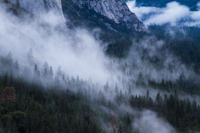 Mist hangs in the air at the base of El Capitan in Yosemite Valley