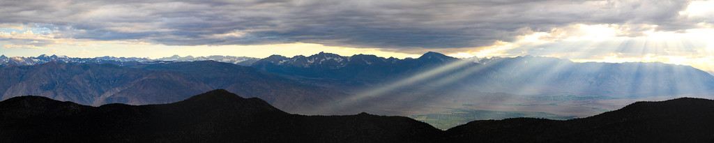 Sunbeams over Bishop, as seen from the White Mts.