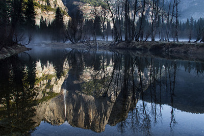 Yosemite Falls reflected in the Merced River on a cold February morning.