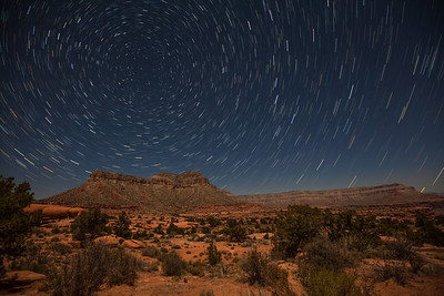 Desert scene with star trails by moon light. Taken from the campground at Toroweap.