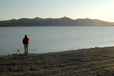 Forrest take a moment in the evening on the shore of Salmon Lake after we hitch a ride from Pilgrim Springs.