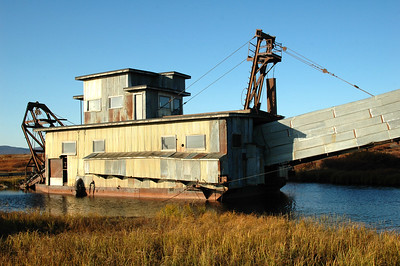 Across the street from the beach an old gold dredge sits right where someone left it many years ago.