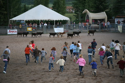 SNOWMASS, CO -  Exploring the Snowmass Rodeo. Mutton Bustin', good eats, bucking broncos, calf chasing, bull riding and barrel racing!