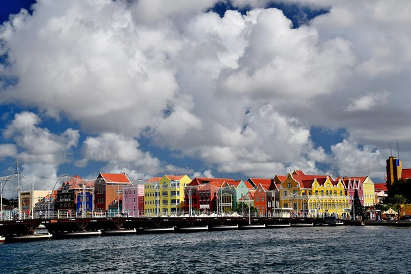 The Queen Emma Bridge is a pontoon bridge across St. Anna Bay in Curaçao. It connects the Punda and Otrobanda quarters of the capital city, Willemstad. The bridge is hinged and opens regularly to enable the passage of oceangoing vessels.