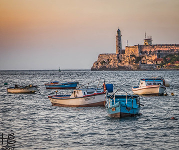 Working boats at sunset