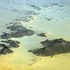 Precambrian rocks with numerous intrusive dikes forming rocky sentinels in the Sahara, Algeria