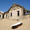 Desert sand invading dilapidated houses in the diamond mining ghost town of Kolmanskop, Namibia