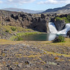 Hjalparfoss waterfall over columnar lava flow, Iceland